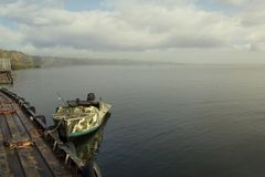 A fishing boat near the pier in a misty morning. Recreation. Travels. Fishing. A fishing boat near the pier in a misty morning. Travels. Fishing Stock Photography