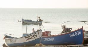 Fishing boat near the sea pier in Pomorie, Bulgaria Royalty Free Stock Photo