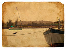 Fishing boat near the shore. Old postcard. Fishing boat near the shore. Old postcard, design in grunge and retro style Royalty Free Stock Images