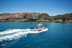 Fishing boat near town Castelsardo, Sardinia Royalty Free Stock Photos