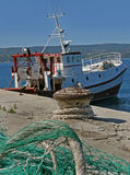 Fishing boat and net in harbor. Fishing boat and net, string, cord in harbor Royalty Free Stock Photo