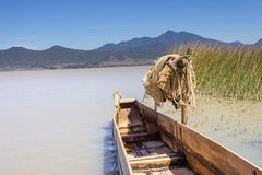 Fishing boat and net. A traditional fishing boat and a fishing net on the shore of Lake Patzcuaro, Mexico Stock Photo