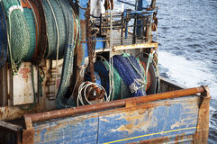 Fishing boat. A fishing boat with nets at sea Stock Photos