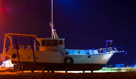 Fishing boat at night royalty free stock photography