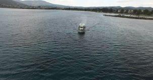 Fishing Boat during Nightfall. A fishing boat is leaving the shore during the nightfall stock video footage
