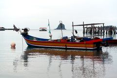 Fishing Boat at black sand beach Langkawi Stock Images