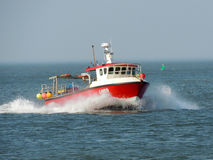 Fishing boat in Norfolk heads for shore Royalty Free Stock Photography