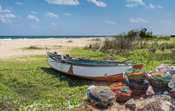 The fishing boat on the ocean coast. royalty free stock images