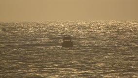Fishing boat in ocean stock video footage