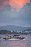Fishing boat, the ocean and the sunset. Ortakent Bodrum, Turkey royalty free stock image