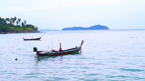 Fishing Boat off the Coast of Phuket Ocean Thailand stock video footage