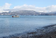 Fishing boat off the spit Royalty Free Stock Image