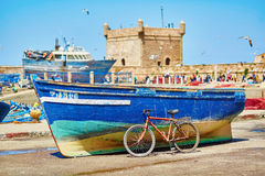 Fishing boat and old bicycle in Essaouira Stock Photo