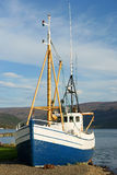 Fishing boat. Old fishing boat on the shore, Talkanfjords, Iceland stock photo