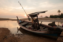 Fishing Boat On A Sea Coast At The Sunrise In Morning