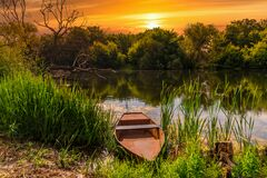 Free Fishing Boat On A Small Lake At Sunset Royalty Free Stock Photo - 175364735