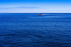 Fishing boat on open water sites Royalty Free Stock Photos