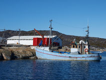 Fishing boat, Oqaatsut, Greenland. Oqaatsut is an old whaling settlement  in Rodebay north of Ilulissat Royalty Free Stock Image