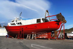 Fishing boat out of the sea for maintenance Stock Photos