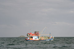 Fishing boat out at sea Stock Photos