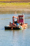 Fishing Boat. Oyster Boat in a bay Stock Photo