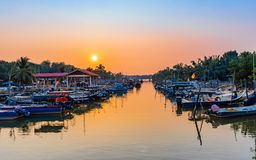 Fishing boat park along the river estuary at the fishing village stock photo