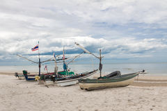 Fishing boat park on the beach with sea background Royalty Free Stock Image