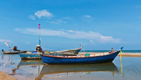 Fishing boat parkat beach Royalty Free Stock Image