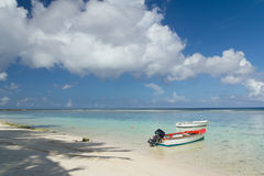 Fishing boat parked by deserted beach. Single Fishing boat parked by deserted beach Royalty Free Stock Photography
