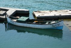 fishing-boat-parked-at-the-docks Royalty Free Stock Images