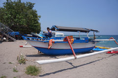 Fishing boat. Parking on the beach while waiting for tourists who rent at the Senggigi, Lombok, Indonesia Stock Image