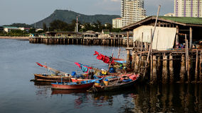 Fishing boat parking at house Stock Image