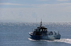 Fishing boat with passengers. Fishing / diving charter boat with passengers on the sea stock photos