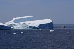 Fishing Boat Passing Large Iceberg Royalty Free Stock Image