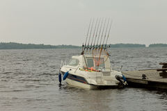 Fishing boat at the pier on a cloudy day Royalty Free Stock Photography