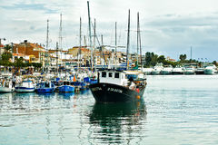 Fishing boat in the port of Cambrils, Costa Dorada, Spain. Port in Costa Dorada, Spain royalty free stock image