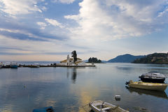 Fishing boat port in Greece. Fishing boat port with a Greek orthodox church in the middle Royalty Free Stock Image