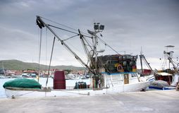 Fishing boat in port, harbor Stock Images