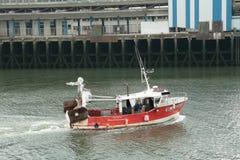 Fishing boat in port Stock Photo