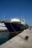 Fishing boat in the port stock photos