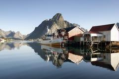 Fishing boat in a quiet fishing pier. Reine, Lofoten island royalty free stock photos