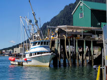 Fishing boat refueling in Alaska. Fishing boat refueling at dock in Juneau, Alaska harbor stock photos