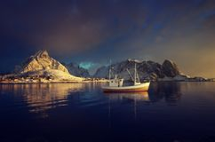 fishing boat and Reine Village, Lofoten Islands stock photos