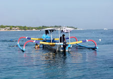 Fishing boat for rent. Traveler rent a fishing boat to explore the island of Nusa Lembongan in Bali, Indonesia Stock Image