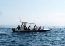 Fishing boat for rent. Traveler rent a fishing boat to explore the island of Nusa Lembongan in Bali, Indonesia Stock Images