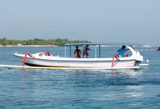 Fishing boat for rent. Traveler rent a fishing boat to explore the island of Nusa Lembongan in Bali, Indonesia Stock Photos