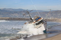 Fishing Boat Rescue. VENTURA, CA, USA - January 8, 2010 - The fishing boat SAI GON I ran aground after 4 people were rescued early morning. The rescue team tried Stock Images