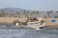 Fishing Boat Rescue. VENTURA, CA, USA - January 8, 2010 - The fishing boat SAI GON I ran aground after 4 people were rescued early morning. The rescue team tried Royalty Free Stock Image