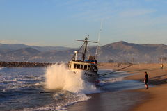 Fishing Boat Rescue. VENTURA, CA, USA - January 8, 2010 - The fishing boat SAI GON I ran aground after 4 people were rescued early morning. The rescue team tried Royalty Free Stock Photos