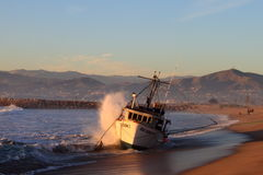 Fishing Boat Rescue. VENTURA, CA, USA - January 8, 2010 - The fishing boat SAI GON I ran aground after 4 people were rescued early morning. The rescue team tried Royalty Free Stock Photo